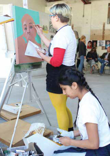 students painting live at the spring exhibition